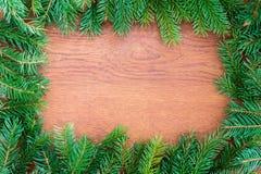 Bożenarodzeniowy jedlinowy drzewo na drewnianej desce Zdjęcie Royalty Free