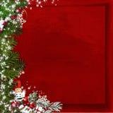 Bożenarodzeniowy jedlinowy drzewo z dziadek do orzechów na rocznik czerwieni tle Obraz Stock