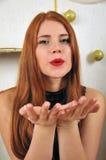 Bożenarodzeniowy kobieta portret z ciosu buziakiem Zdjęcie Stock