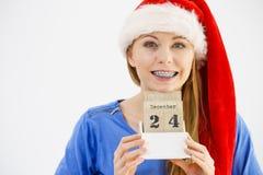 Bożenarodzeniowy kobiety mienia kalendarz Zdjęcie Stock