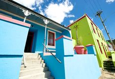 Bo-kaap pastel Buildings. Cape Town,Bo-Kaap-19 February 2015: Pastel colours and quaint homes in Bo=Kaap street scene, Cape Town Royalty Free Stock Images