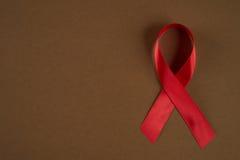 Bo med HIV-HJÄLPMEDEL royaltyfri foto