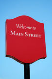 Boa vinda ao sinal de rua principal Fotografia de Stock Royalty Free