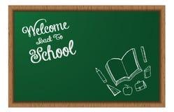 Boa vinda de volta ao quadro-negro da escola com garatujas Fotografia de Stock Royalty Free