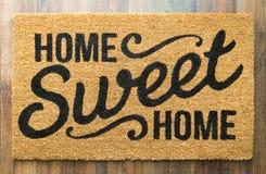 Boa vinda doce home Mat On Floor da casa foto de stock royalty free
