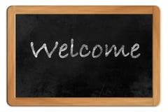 Boa vinda em um quadro-negro Fotografia de Stock