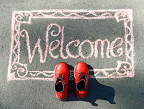 Boa vinda, inscrição no giz Imagens de Stock
