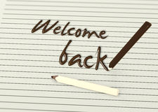 Boa vinda para trás por lápis do chocolate no papel Fotos de Stock Royalty Free