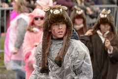 Boar boy wrapped up against rain at Carnival parade, Stuttgart Royalty Free Stock Image