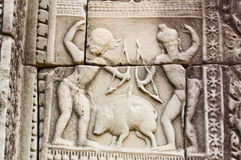 Boar Hunting, Ancient Khmer Carving Stock Images