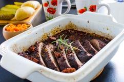 Boar roast in the baking form stock photo
