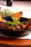 Boar stew. Hearty boar stew with herbs, Spanish cuisine Royalty Free Stock Photo