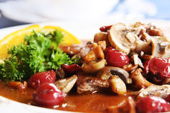 Boar stew with mushroom and cherry Stock Image