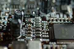 Board. Close up of computer board with microchip, resistors and condensators Stock Images