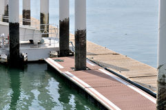 Board access on dock platform. Access on dock, shown as facilities of dock, maritime activities, sport or entertainment industry Royalty Free Stock Photo