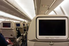 Blank screens display with black copy space on airplane seat monitors royalty free stock photos