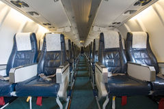Board of the airplane. Inside view Stock Photos
