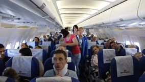 On board of airplane. People aboard an airplane stock video