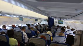 On board of airplane. People aboard an airplane stock footage