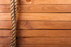 Board background. Wooden board background with rope Stock Photo