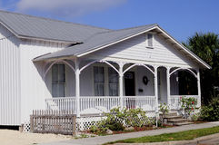 Board and batten construction. A small house shows simple wooden columns and balustrades in a typical older home Punta Gorda Florida. THis home uses board and royalty free stock photos