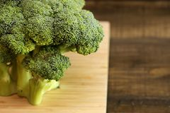 Board with broccoli on the table royalty free stock photography