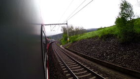 An on-board camera footage: landscape sweeps along as the train continues riding.  stock video footage