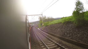 An on-board camera shoots the passing landscape in the late afternoon.  stock footage
