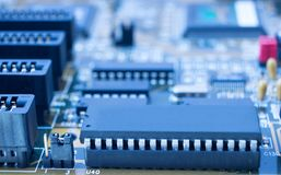 Printed circuit motherboard with slots, processors. On board are capacitors resistors, slots, integrated circuits, diodes, microprocessor Stock Image
