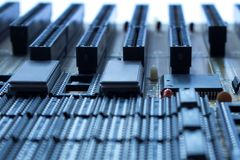 Printed circuit board with slots. On board are capacitors resistors, slots, integrated circuits and microprocessor Royalty Free Stock Photos