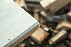 Board chamfered on the background scraps. Processing edged boards, mowing angle Stock Image