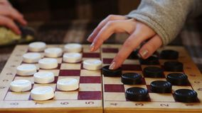 Hands move checkers on the Board stock footage