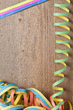 Board with colorful streamers Royalty Free Stock Images