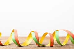 Board with colorful streamers Stock Photos