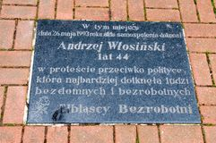 Board for commemorate a self-immolation by Andrzej Wlosinski in May 26, 1993. Elblag, Poland - September 9, 2017: Board for commemorate a self-immolation by Royalty Free Stock Photos