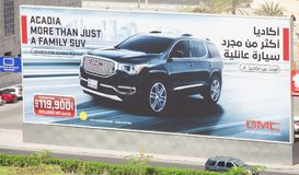 Board commercial of GMC suv car, 4x4 new vehicle for sale. DUBAI, UAE - SEPTEMBER 25 2018: board commercial of GMC suv car, 4x4 new vehicle for sale royalty free stock images