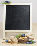 Board for culinary recipes and the menu. On a photo a blank  blackboard  on which the designer can enter the menu or the recipe of a dish Stock Images