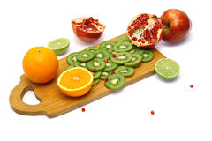 Board with cut fresh fruits Stock Images