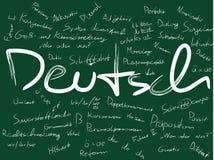 Board with Deutsch (German). Handwritten German language and grammar learning words on green background stock illustration