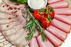Assorted meat and ham delicacies stock image