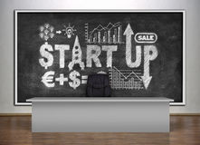 Board with drawing start up Stock Photos