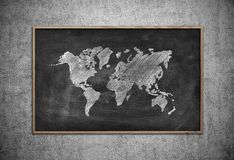 Board with drawing world map Royalty Free Stock Images