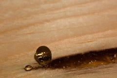 Board with a drop of vegetal resin is macro. Board with a drop of vegetal resin is close stock photography