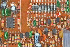 Board with electronic components. The printed-circuit board with electronic components macro background Royalty Free Stock Images