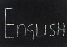 Board with ENGLISH. The word English written in chalk on a black board Stock Image