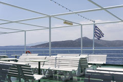 On board a ferry boat with the Greek flag Royalty Free Stock Photography