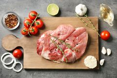 Board with fresh raw steak with thyme. On table Royalty Free Stock Photos