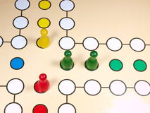 Board game. Childrens board game with colour pawns stock photography