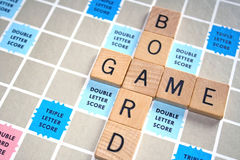Board Game. The words Board and Game spelled out using lettered wood tiles Royalty Free Stock Photo