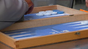 Board game backgammon closeup. Close up of two men playing board game tavli or backgammon stock footage